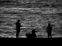 Sea warriors (1jonathan1) Tags: sunset man fisherman caribbean sea ocean people street bike water shadows sun light blackandwhite blancoynegro monocromo walk colombia travel cartagenadeindias old city