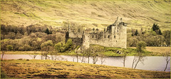 Kilchurn Castle (williamwalton001) Tags: scotland stone trees texture pentaxart water woodlands weather grasses mountains colourimage historic island ruins tones trolled sincity trollieexcellence