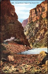 "Postcard #8696 ""Second Tunnel, Canon of Grand River, Colo."" The Gray News Co. (ca. 1918). Original photo by William Henry Jackson (ca. 1899) (lhboudreau) Tags: postcard postcards colorphoto outdoor outdoors colorado vintagepostcard rail railroad train trains glenwoodcanyoncolorado glenwoodcanyon no8696 8696 postcard8696 postcardno8696 gorge canyon steamrailroad steamengine cliffs rock rocks rockwall rockwalls grandriver coloradoriver tunnel tunnels secondtunnel canonofthegrand canonofgrandriver canon graynewsco graynewscompany thegraynewsco 1918 1899 williamhenryjackson steam river water locomotive steamlocomotive"
