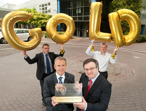 Employment and Learning Minister Dr Stephen Farry presented Schrader Electronics with an Investors In People Gold Award. Also pictured Stephen McClelland Schrader Managing Director and Ailsa McNeill, Schrader Head of Human Resources.