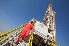 An operator on the LR5 Drilling Rig, Khazzan Project, Oman. (BP_images) Tags: hardhat hat project high hard wells east rig ear overalls production hi middle bp exploration oman vis defenders operator ep coveralls drilling ppe visability lr5 khazzan