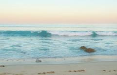 glimmering waters (Ani Carrington) Tags: ocean blue sunset sky beach water mexico sand rocks waves skies bajacalifornia baja bajacaliforniasur
