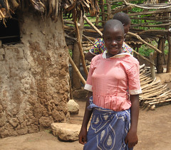 Ugandan schoolgirl, 2010 (Trust for Africa's Orphans) Tags: africa charity girl kids children child orphans huts hut thatch uganda tao thatchedcottage charitable africanchildren africanhuts trustforafricasorphans supportingorphans improvingagriculture ugandanhut taorphans doit4orphans
