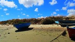Ebb-tide (Harmen de Boer) Tags: vacation sky fish beach portugal clouds faro boats coast spain tide wreck ebb