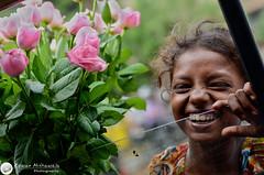 A LITTLE CHEER AT THE TRAFFIC SIGNAL (© Rizwan Mithawala) Tags: street roses india streets flower rose 50mm prime nikon streetphotography photojournalism wm bombay maharashtra nikkor mumbai seller f28 hdr streetkid hajiali flowerseller rizwan deller slumdogmillionaire d5100 mithawala 50mm18g girldsc1029