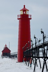 Stand Up_Grand Haven Lighthouse (Sneezzzzz) Tags: travel winter red lighthouse white lake snow ice frozen unitedstates michigan grandhavenlighthouse 5photosaday nikond40