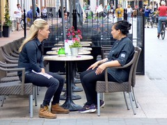 Voor en achter de geraniums . (Franc Le Blanc .) Tags: people lumix women sitting candid panasonic sit streetphoto seated shertogenbosch