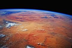 African Desert Mountains (sjrankin) Tags: africa mountains clouds sand desert edited nasa hills limb sanddunes iss saharadesert earthslimb iss040 12july2014 iss040e45474