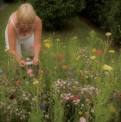 """Wife on a """"photo-walk"""" in our garden... (iEagle2) Tags: camera flowers wife cleavage"""