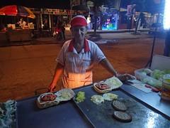 """Une petite mamie qui prépare nos burgers, ils sont super bons en plus! • <a style=""""font-size:0.8em;"""" href=""""http://www.flickr.com/photos/113766675@N07/14494907420/"""" target=""""_blank"""">View on Flickr</a>"""