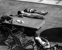 Sun Worshiper (fillzees) Tags: bw woman girl table person ut chair furniture pavement candid bikini poolside swimsuit swimwear supine