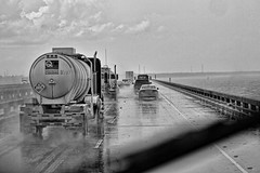 WeeGee's SqueeGee (raymondclarkeimages) Tags: road travel bw usa water rain weather truck canon river mono blackwhite driving 7d tanker weegee pictureof picof raymondclarkeimages 8one8studios