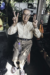 The Old Man in a Mango Store (PandaOppa) Tags: red people human farm sekinchan malaysia river ocean fujifilm moment sky selangor