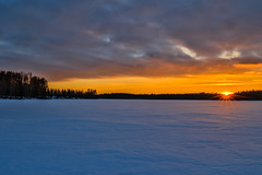 Last sun rays of the day (ArtDvU) Tags: lake lakescape landscape icy winter spring northern ostrobothnia sunset clouds shore sun canon eos 7d mkii finland