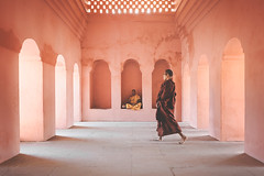 Monks. Bodhgaya, India (Marji Lang Photography) Tags: india traveldestinations buddhistmonk buddhism composition travel bihar bodhgaya pilgrimage twomonks people buddhisttemple pastelcolors serenity peaceful mood atmosphere serene templebuilding arches alcoves geometry space warm tones