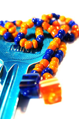 Macro Mondays –  Orange and Blue (macduff312) Tags: macromondays macro monday orange blue key white bead bracelet canon d600 60mmmacro