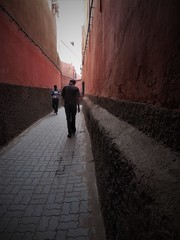 where paths cross (SM Tham) Tags: africa morocco marrakech oldmedina walledcity unescoworldheritagesite street lane streetscene buildings walls people perspective