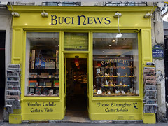 Read it in the Sunday Papers (Eddie C3) Tags: parisfrance vacationphotos latinquarterparis news storewindows storefronts
