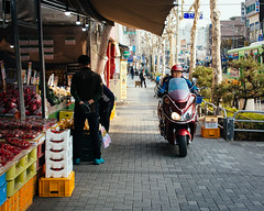 Sidewalk Motorist (Kevin Lowry) Tags: korea 35mm18 nikon motorbike streetphotography seoul