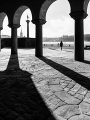 Stockholm, April 4, 2017 (Ulf Bodin) Tags: spring sverige streetphotography outdoor shadows vår urban monochrome sweden woman pillars blackandwhite stockholm stadshuset kungsholmen urbanlife stockholmslän se