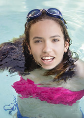 The Joy of Swimming (SteveFrazierPhotography.com) Tags: chrissy swimming swimmer water pool girl youngwoman teen teenager wet sunlight goggles hair smile smiling stevefrazierphotography may 2016 millennial