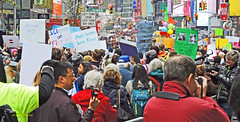 Earth Day NYC-1 (albyn.davis) Tags: timessquare nyc newyorkcity people march protest street signs colors colorful bright vibrant vivid demonstration politics photojournalism photographer crowd manhattan