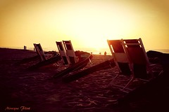 Morning at the Beach (moniquef123) Tags: morning beach sunrise chairs landscape sand sky ocean seaside vacation orange weather weatherphotography