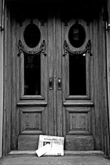 Door With New York Times - Black & White Version; New York, New York (hogophotoNY) Tags: door wood city nyc newyorkcity blackandwhite bw usa news film analog photo newspaper olympusstylusepic doors famous doorway fujifilm converted filmcamera stylusepic thenewyorktimes olympusstylus morningpaper convertedtobw olympusstylusepicdlx thepaper cultcamera themorningpaper stylusepiccamera