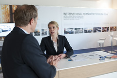 Carolin Müller discusses with a visitor, at the BMW stand
