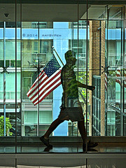 Free To Be Transparent (Art By Pem Photography: Tao Of The Wandering Eye) Tags: city travel windows urban usa man reflection building brick window glass america reflections walking lumix person flag perspective citylife cities americanflag panasonic american brickwall walkway americana transparent fineartphotography