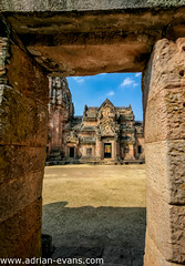 Khmer Temple (Adrian Evans Photography) Tags: sky monument stone architecture asian thailand temple ancient sandstone shrine khmer exterior outdoor buddha religion landmark unesco worn shiva wat hindu buriram phanomrung isan mountkailash issan laterite stonecastle prasathinphanomrung