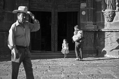 outside a church.. (camelot98.) Tags: street leica city travel light shadow blackandwhite bw sun man blanco church contrast dark mexico mood dof child bright candid negro streetphotography rangefinder mexican sanmigueldeallende summilux m9