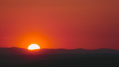Sunlight Star Bright (John Westrock) Tags: light sunset red sky orange sunlight mountains nature canon landscape outdoors warm pacificnorthwest washingtonstate pnw issaquah olympicmountainrange canonef100400mmf4556lisusm canoneos5dmarkiii johnwestrock