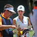 American Jennifer Johnson (r) and her caddie discuss her club selection on a short par 3 on Pinehurst No. 2.