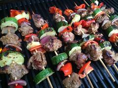 Grilling lamb kebabs.