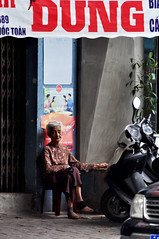 Granny takes a break (Roving I) Tags: grannies elderly greyhair resting relaxation shops signs footpaths street danang lifestyle vertical vietnam