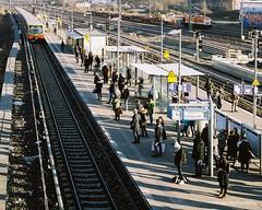 People waiting for the train (danielfoster437) Tags: berlin publictransportation peoplewaitingfortrain berlintourism railwayplatform railplatform berlinsbahn waitingforthetrain trainplatform bahnhof berlinwarschauerstr oncomingtrain rolleiflex28 incomingtrain