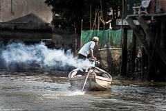 Boatman, Mekong river (albertlondon) Tags: vietnam mekongriver fishermen fishingvillage halongbay saigon hanoi boats fishing