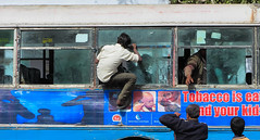 IMG_31020 (Manveer Jarosz) Tags: bharat hindustan india mathura uttarpradesh ad advertisement bus cheap climbing commute crazy crowded lowbudget man outdoors outside overcapacity people ride riding rural station tobacco travel traveler warning window
