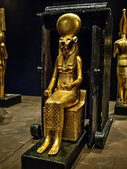 Seated figure of the goddess Sekhmet ona throne New Kingdom 18th Dynasty Egypt 1332-1323 BC (mharrsch) Tags: figure figurine sculpture statue pharaoh king ruler tutankhamun burial tomb funerary 18thdynasty newkingdom egypt 14thcenturybce ancient discoveryofkingtut exhibit newyork mharrsch premierexhibits gold goddess deity religion sekhmet feline