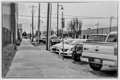 Parked Cars (brev99) Tags: d610 nikon50mmf18d tulsa bradyartsdistrict urban cityscape blackandwhite silverefex perfecteffects17 on1photoraw2017 ononesoftware colorefex imageborder cars bokeh filmanalog analogefexpro2