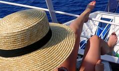 Relax (alfonsocarlospalencia) Tags: relax robado piernas sexy grecia islas jónicas uñas rojo proa paz océano sombrero misterio azul belleza infinito aislado luz atardecer escondite