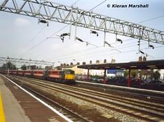 87015 arrives at Stafford, 5/8/04 (hurricanemk1c) Tags: 2004 train railway trains virgin railways scannedphoto gec stafford virgintrains brel class87 virginwestcoast 87015 class870 howardofeffingham britishrailengineeringltd virgintrainsredandblack