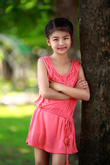 Happy young asian girl (Patrick Foto ;)) Tags: park autumn summer portrait people plant color tree cute green nature girl beautiful grass childhood smiling horizontal female standing forest garden asian fun thailand outside outdoors happy person one kid spring hugging child looking natural image little background young posing lifestyle environmental happiness growth thai trunk environment cheerful protection leaning