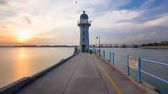 Estus (Wolfics) Tags: ocean light sunset sea cloud sun lighthouse house building tower architecture marina concrete singapore wide rail railing raffles uwa tuas