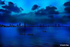 Blue line (debriddhi) Tags: blue sea sky cloud india color water colors skyline clouds canon photography asia cityscape dusk mumbai urbanscape backwater incredibleindia lpexperiment