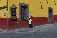 with pockets full.. (camelot98.) Tags: street leica city travel windows light shadow red urban color geometric lines yellow contrast mexico streetphotography sunny mexican sanmigueldeallende guanajuato m9 bight
