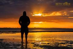 Liquid Gold (Beth Wode Photography) Tags: sunset sundown sunrays goldensunset reflections silhouette man silhouettedman orangesunset lowtide wellingtonpoint redlands beth wode bethwode