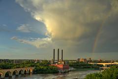Rainbow over the milling district (schwerdf) Tags: bridges cloudscapes endlessbridge guthrietheater hdr i35wstanthonyfallsbridge millingdistrict minneapolis minnesota rainbows southeaststeamplant stonearchbridge tcrt thunderclouds