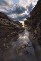 Renaissance-rock---Jumping-gully-II (Robalabob1) Tags: sea seascape water ocean pool rocks gully shallow cliff clouds sun moody wales anglesey porth diana trearddur bay beach